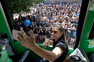 NASCAR driver Danica Patrick takes a selfie from a tour trolley car as students from the Warren-Prescott school give her a send-off rally for a tour of historic sites, Wednesday, June 14, 2017, in Boston. (AP / Elise Amendola)