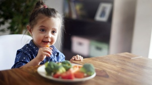 In a new study, researchers urge parents not to give up on encouraging children to eat their greens. (gpointstudio / Istock.com)