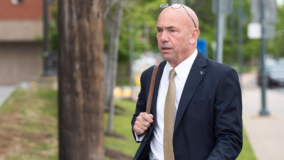 RCMP Commissioner Bob Paulson arrives to testify at the RCMP's trial on violating four charges of the Canada Labour Code in Moncton, N.B. on Thursday, June 15, 2017. The charges are related to the June 2014 shooting spree that claimed the lives of three officers. (THE CANADIAN PRESS/Andrew Vaughan)