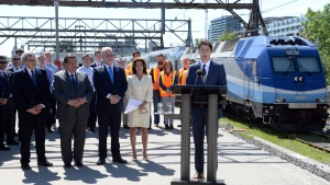 Prime Minister Justin Trudeau announces a $1.28-billion commitment toward a major Montreal rail project that will connect the city to its suburbs and to its international airport as Michael Sabia, the head of the province's public pension fund manager, left to right, Montreal Mayor Denis Coderre, Quebec Premier Philippe Couillard and Michele Boisvert look on Thursday June 15, 2017. THE CANADIAN PRESS/Paul Chiasson