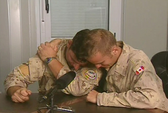 Trooper Steve Davidson, right, and Cpl. Wade Wick become emotion after speak about the death of their friend, Darryl Caswell.