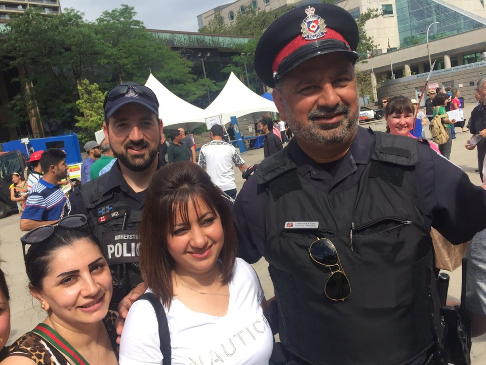 Emergency services personnel welcomed hundreds of new Canadians in Windsor, Ont., on Thursday, June 15, 2017. (Sacha Long / CTV Windsor)