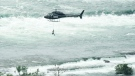 Erendira Wallenda dangles from a helicopter performing a stunt over the Niagara Falls in Niagara Falls, Ont., on Thursday, June 15, 2017. Wallenda performed a series of movements while on a hoop suspended from the helicopter, including hanging from her teeth, her toes and her knees.THE CANADIAN PRESS/Nathan Denette