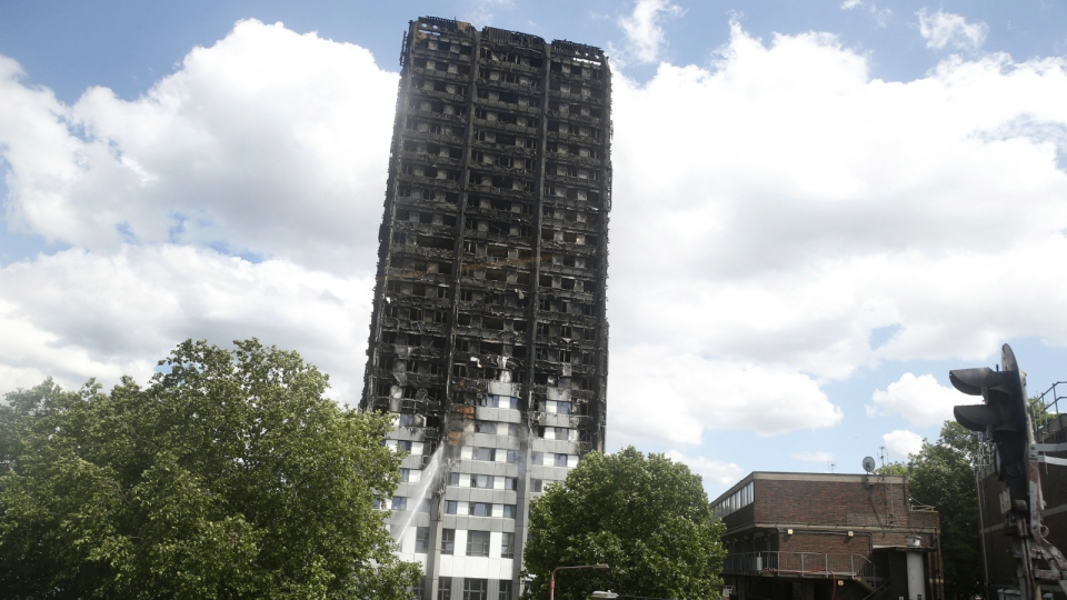 A view of the charred facade of the Grenfell Tower in London on Thursday, June 15, 2017. (AP / Alastair Grant)