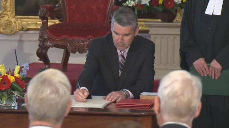 Nova Scotia Premier Stephen McNeil is sworn in at the provincial legislature on June 16, 2017.
