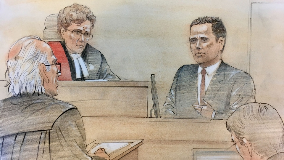 Officer Leslie Nyznik answers questions from his lawyer Harry Black in court Friday June 16, 2017. (John Mantha /CTV News Toronto)