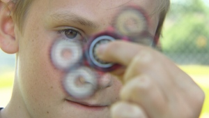 Cole Counsell shows off his homemade fidget spinner which he sells online. (CTV)