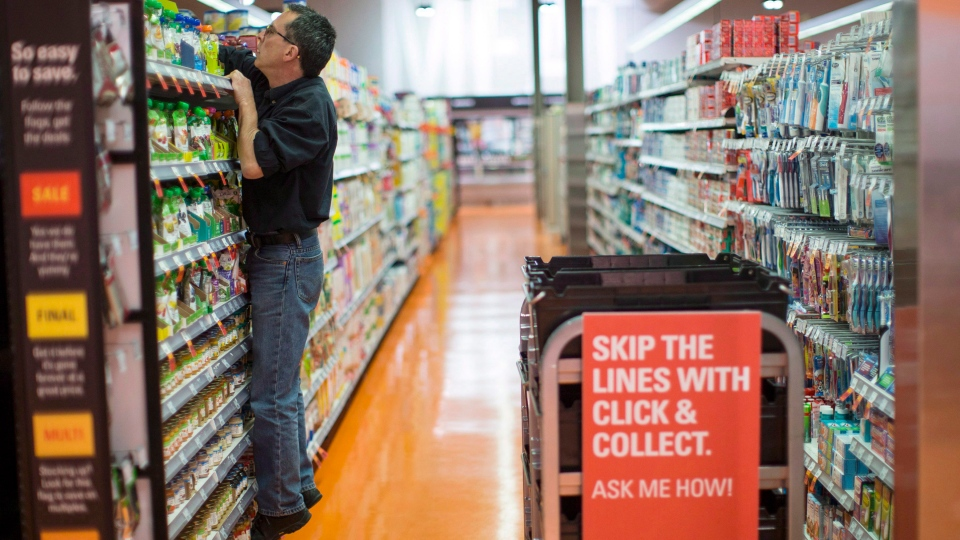 Grant Bone, Department Manager for Loblaw's 'Click and Collect,' gathers a customer's order at one of the grocery chain's outlets in Toronto, on Thursday, June 16, 2016. (THE CANADIAN PRESS/Chris Young)