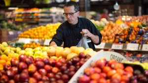 Grant Bone, Department Manager for Loblaw's 'Click and Collect' gathers a customer's order at one of the grocery chain's outlets in Toronto on June 16, 2016. (Chris Yo / THE CANADIAN PRESS)