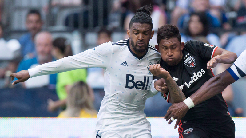 Vancouver Whitecaps' Sheanon Williams, left, has been suspended indefinitely by Major League Soccer after the defender was charged with assault in connection with an alleged domestic incident. (THE CANADIAN PRESS/Darryl Dyck)