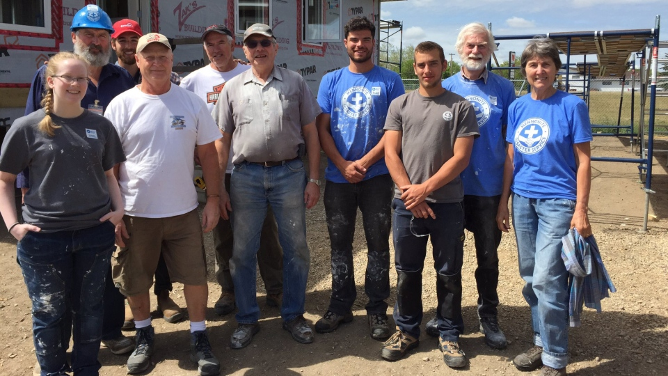 Volunteers in Hague, Sask., building homes for Fort McMurray families pose for a photo. (Mark Villani/CTV Saskatoon)