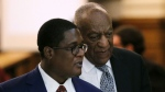 Actor and comedian Bill Cosby walks with his publicist, Andrew Wyatt, during deliberations in Cosby's sexual assault trial at the Montgomery County Courthouse in Norristown, Pa., Friday, June 16, 2017. (Lucas Jackson / Pool Photo via AP)