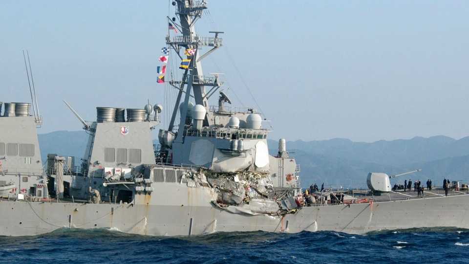 In this photo provided by Japan's 3rd Regional Coast Guard Headquarters, the USS Fitzgerald is seen off Izu Peninsula in, Japan, after the Navy destroyer collided with a merchant ship, Saturday, June 17, 2017. (Japan's 3rd Regional Coast Guard Headquarters via AP)