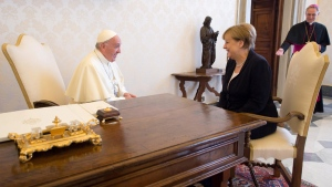 Pope Francis and German Chancellor Angela Merkel sit at a table on the occasion of their private audience, at the Vatican, Saturday, June 17, 2017. (L'Osservatore Romano/Pool Photo via AP)