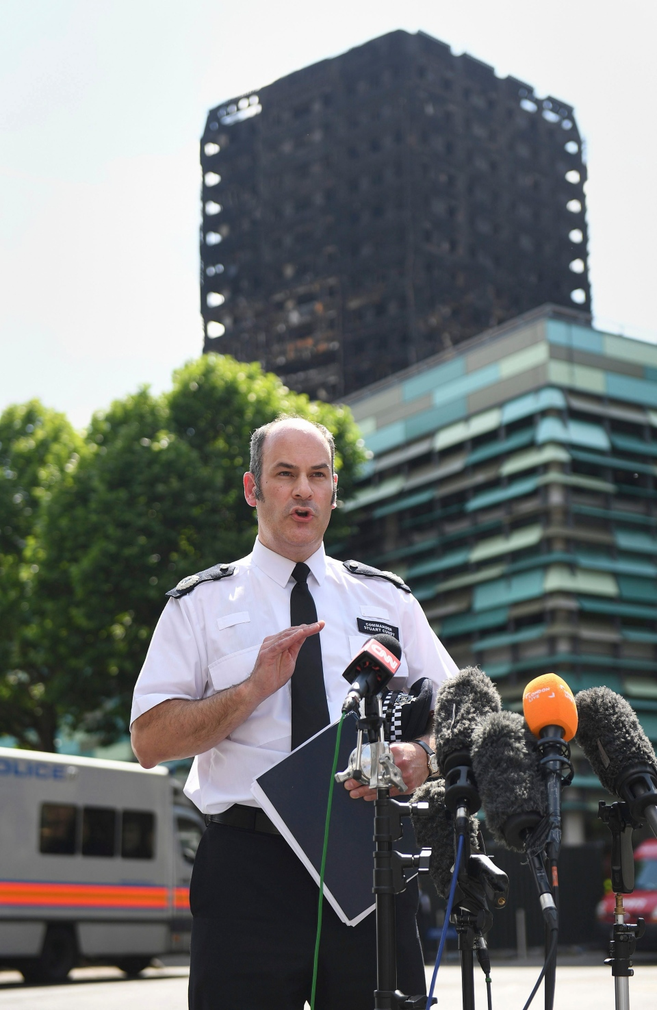 Metropolitan Police Commander Stuart Cundy speaks to the media near Grenfell Tower after a fire engulfed the 24-storey building, in London, Saturday June 17, 2017. (Victoria Jones/PA via AP)