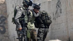 Israeli border police arrest a Palestinian during clashes in the West Bank village of Deir Abu Mash'al near Ramallah, Saturday, June 17, 2017. (Nasser Shiyoukhi/AP Photo).