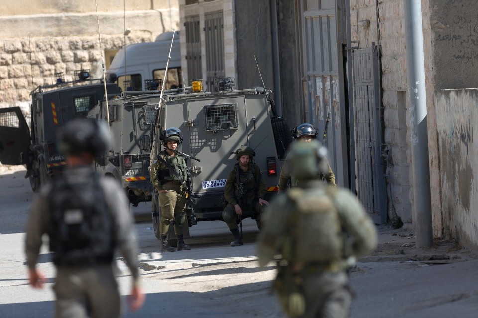 Israeli security forces raid the West Bank village of Deir Abu Mash'al near Ramallah, Saturday, June 17, 2017. Israel security forces raided the village a day after an attack in Jerusalem killed a police officer. The three Palestinian attackers were from the village. (Nasser Shiyoukhi/AP Photo).
