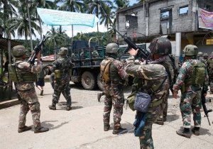In this May 30, 2017, file photo, Philippines government troops prepare to head to the frontline as fighting with Muslim militants in Marawi city enters its second week in southern Philippines. (AP / Bullit Marquez)