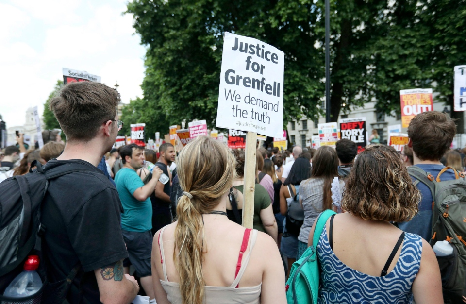 People gather in Whitehall, to protest after the fire at Grenfell Tower which engulfed the 24 storey building on Wednesday, in London, Saturday June 17, 2017. (Jonathan Brady/PA via AP)