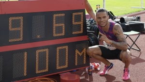 Andre De Grasse celebrates his win in the mens 100m next to a board showing his time of 9.69, ahead of Ben Youssef Meite, of Ivory Coast during the athletics IAAF Diamond League meeting at Stockholm Stadium on Sunday, June 18, 2017. (Anders Wiklund / TT)