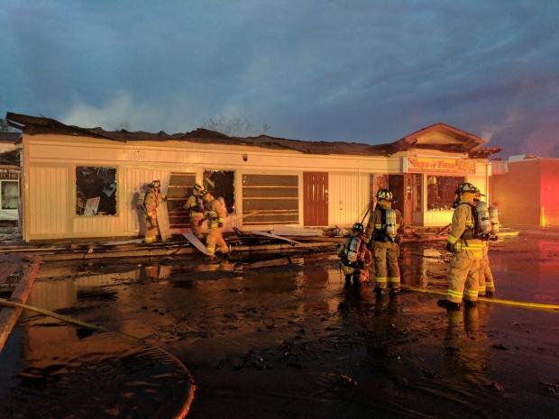 Firefighters battle a blaze in Manotick