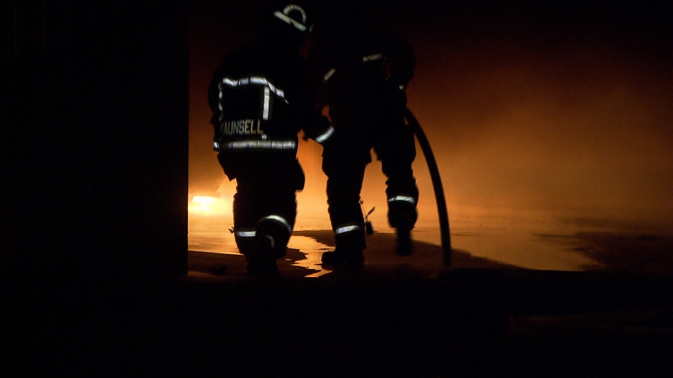 Firefighters work to put out a blaze that started in the parkade of St. Augustine's just after 1 a.m. Sunday. (CTV)