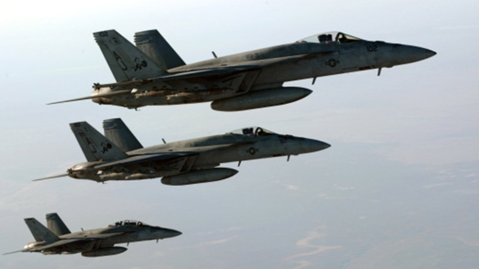 In this Sept. 23, 2014 photo released by the U.S. Air Force, a formation of U.S. Navy F-18E Super Hornets leaves after receiving fuel from a KC-135 Stratotanker over northern Iraq, as part of U.S. led coalition airstrikes on the Islamic State group and other targets in Syria. (AP Photo/U.S. Air Force, Staff Sgt. Shawn Nickel)