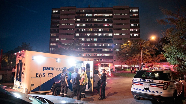 Police, paramedics and firefighters are seen at Firvalley Court on June 18, 2017. (John Hanley)