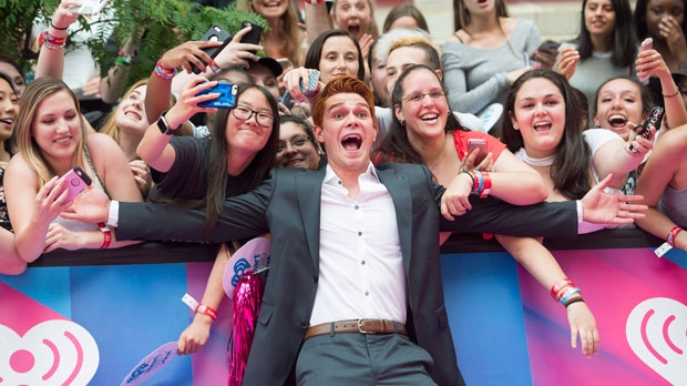 KJ Apa arrives on the red carpet at the 2017 Much Music Video Awards in Toronto on Sunday, June 18, 2017. THE CANADIAN PRESS/Nathan Denette