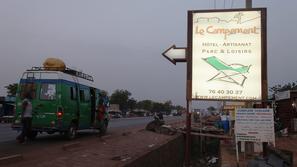 A sign points to Campement Kangaba, a hotel resort, near Bamako, Mali, Sunday, June 18, 2017. Suspected jihadists attacked the hotel resort Sunday in Mali's capital, taking hostages at a spot popular with foreigners on the weekends. (AP Photo/Baba Ahmed)