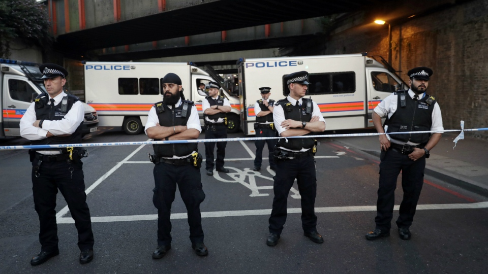 Police stand guard at a cordon on a road near Finsbury Park station after a vehicle struck pedestrians in north London on Monday, June 19, 2017. (AP / Tim Ireland)
