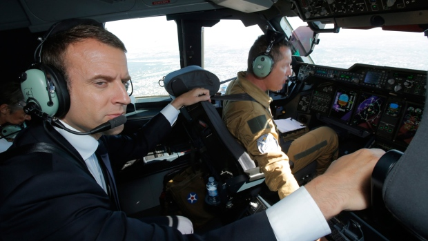 French President Emmanuel Macron in an Airbus A400