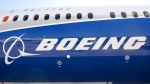 View taken of the Boeing logo on the fuselage of a Boeing 787-10 Dreamliner test plane presented on the Tarmac of Le Bourget on June 18, 2017 on the eve of the opening of the International Paris Air Show. (ERIC PIERMONT / AFP)