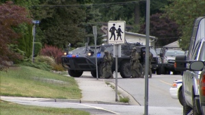 Emergency Response Team members respond to a call of a distraught man firing a weapon in Port Coquitlam. June 18, 2017. (CTV)