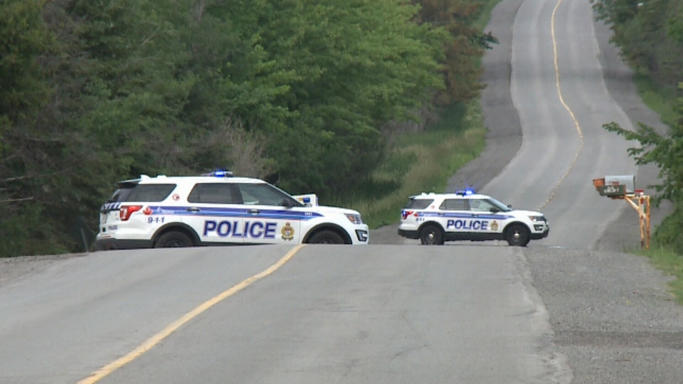 Police vehicle block the road where a fatal rollover occurred near 7025 Fernbank Road, Stittsville just before 9:30 p.m. Sunday, Jun. 18, 2017.