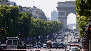 Police forces secure the Champs Elysees in Paris