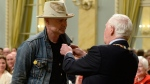 Gord Downie receives the Order of Canada from Governor General David Johnston in Ottawa on Monday, June 19, 2017. Downie, who announced last year that he was diagnosed with terminal brain cancer, has become a strong advocate for indigenous people and issues. THE CANADIAN PRESS/Adrian Wyld