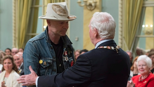 Governor General David Johnston shakes hands with Tragically Hip singer Gord Downie after investing him in the Order of Canada during a ceremony at Rideau Hall, Monday, June 19, 2017 in Ottawa. THE CANADIAN PRESS/Adrian Wyld