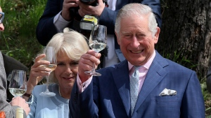 Camilla the Duchess of Cornwall and Prince Charles, from left, toast as they taste wines at a wine tavern in Vienna, Austria, April 6, 2017. (Ronald Zak/AP)