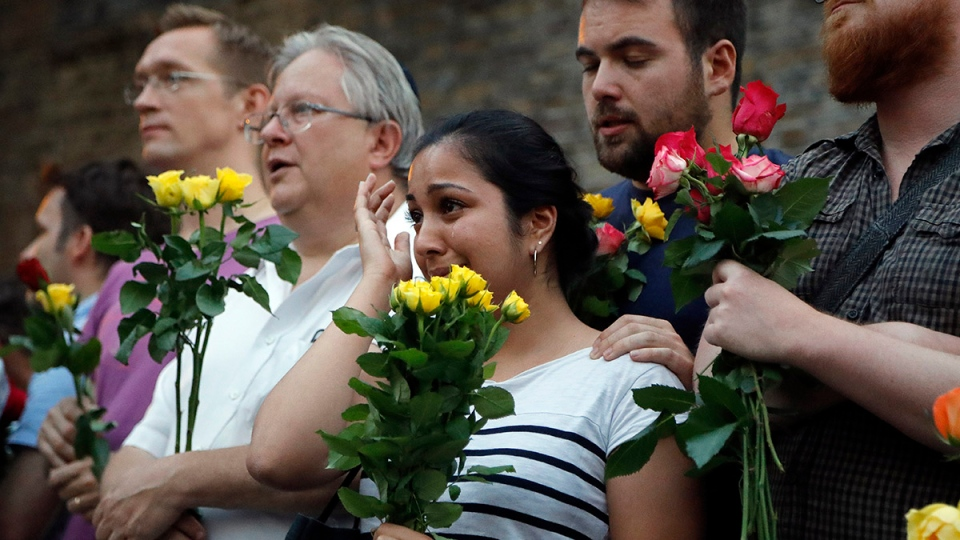 People take part in a vigil at Finsbury Park in north London, where a vehicle struck pedestrians in north London Monday, June 19, 2017. A vehicle struck pedestrians near a mosque in north London early Monday morning. (AP Photo/Frank Augstein)