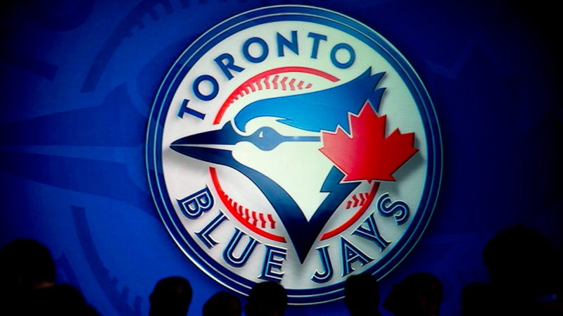 People wait for the launch of the Toronto Blue Jays new uniforms with a familiar look that connects the past with the future in Toronto on Friday, Nov. 18, 2011. (Nathan Denette/The Canadian Press)