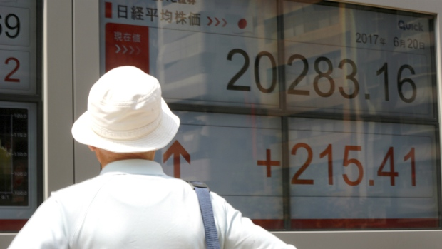 China stocks slip ahead of MSCI decision, liquidity concerns linger