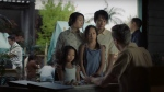 An actor and actresses are seen portraying Vietnamese refugees in this still taken from the latest Heritage Minute, released on June 20, 2017. (Historica Canada)
