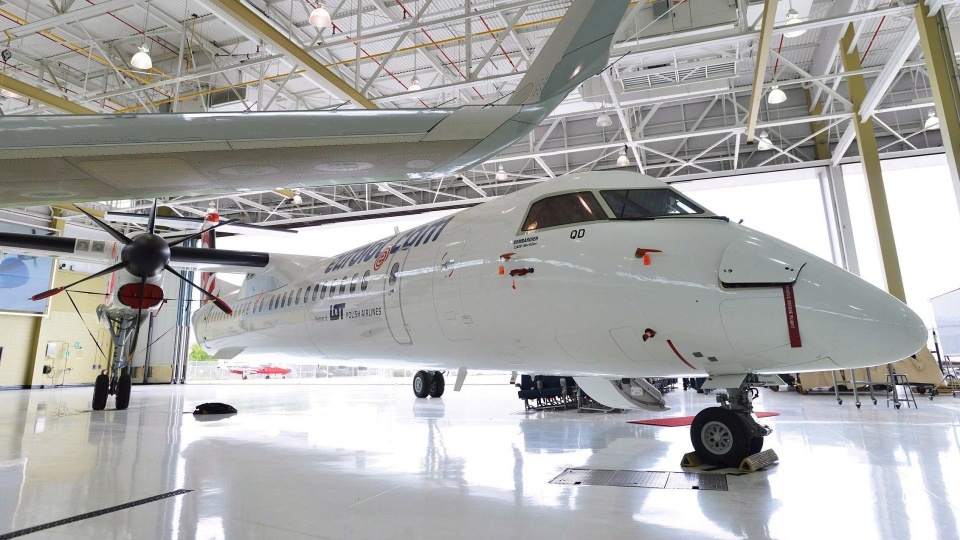 A Bombardier Q400 jet sits in a hangar at the Bombardier facility in Toronto on July 25, 2012. (Aaron Vincent Elkaim/The Canadian Press)