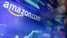 In this Tuesday, May 30, 2017, file photo, the Amazon logo is displayed at the Nasdaq MarketSite, in New York's Times Square. (Richard Drew/AP)