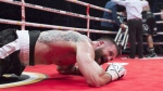 Adam Braidwood, left, of Richmond, B.C., reacts after knocking down Eric Martel-Bahoeli, of Quebec City, during a WBU Heavyweight title fight, in Quebec City on Friday, February 24, 2017. (THE CANADIAN PRESS/Jacques Boissinot)