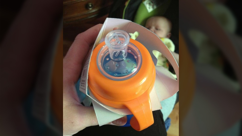 Jessica Szucki is shown holding the sippy cup her son Dryden, 6, prefers to drink from. (Jessica Szucki / Facebook)