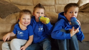 Jessica Szucki's three children are shown with their sippy cups. Dryder, 6, is shown on the right. (Jessica Szucki / Facebook)