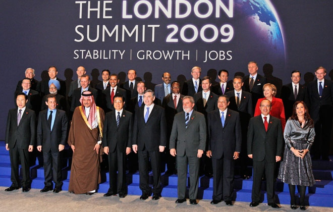 Summit host British Prime Minister Gordon Brown, front row centre, stands with the other G20 leaders during a group photo at the G20 Summit in the Excel centre in London, Thursday, April 2, 2009.  (AP / Kirsty Wigglesworth)