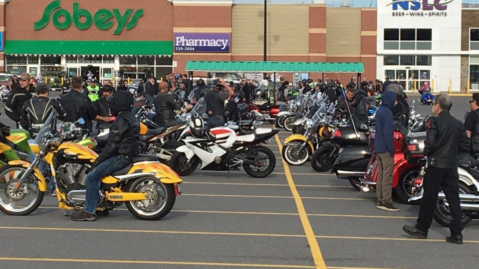Dozens of bikers congregated in a grocery store parking lot before heading to Xander Rose's home. (Kyle Moore / CTV Atlantic)